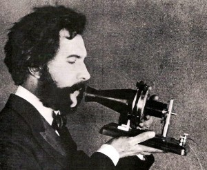Bell speaking into his telephone, 1876