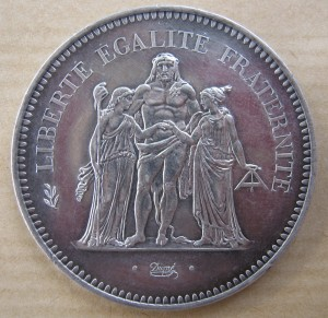 On the French 50 Francs coin, Liberty (on the left) stands with Hercules and Justice.